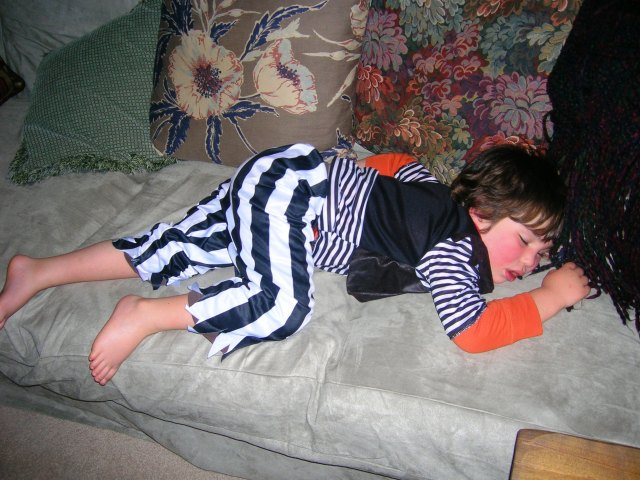 Exhausted little pirate crashes out on the couch